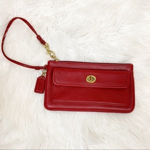 Coach red and gold leather wristlet
